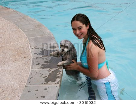 Young Girl And Dog Swimming