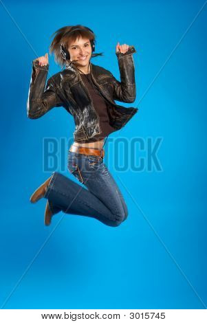 Girl With Headphones Jumping