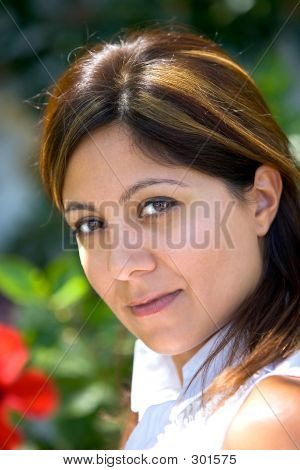 Pretty Young Spanish Girl Looking At Camera