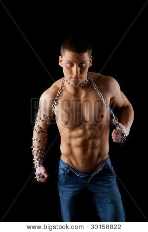 yong aggressive man with chain on hands