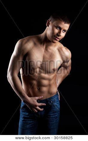 Strong naked man portrait in jeans