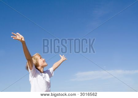 Child Arms Raised In Joy
