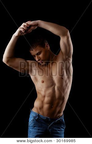 beauty athletic male posing nude in dark