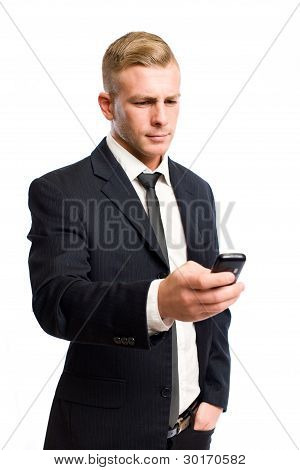 Confident Young Businessman Using His Cellphone.