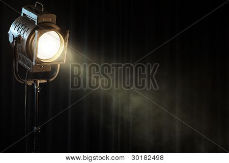 Vintage Theatre Spot Light On Black Curtain With Smoke
