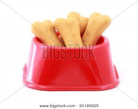 Dog food bowl with dog biscuits shaped like bones