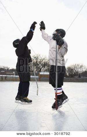 Hockey Players High Fiving.