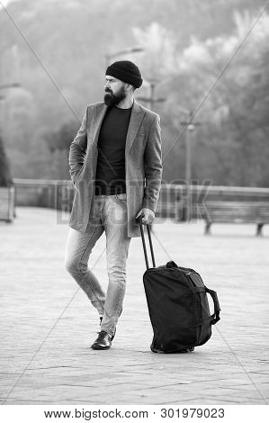 poster of Ready To Travel. Carry Travel Bag. Business Trip. Man Bearded Hipster Travel With Big Luggage Bag On