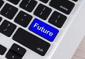 Future Time Concept. Word Future On Blue Computer Keypad Button, Closeup poster