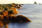 Long Exposure Of Rocky Sea Shore & Blue Water On Sunset. Seascape,south China Sea Coastline, Seaside poster