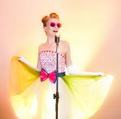 Happy Girl Singer In Pink Glasses Smiles, Flirts, Enjoys Life, Dances, Have Fun, Sings Into Silver R poster
