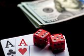 Close-up - Two Aces, Playing Cards, Red Gaming Dices And Stack Of American Dollars On Black Table. C poster