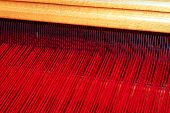 foto of handloom  - Close up shot of loom with red thread - JPG