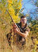 Hunter With Rifle Ready To Hunting Nature Background. Hunting Skills And Strategy. Hunting Strategy  poster