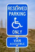 Blue Reserved Parking Van Accessible Sign With A Man On A Wheelchair Icon poster