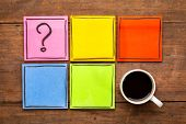 question mark and blank reminder notes - handwriting on colorful sticky notes with a cup of black co poster