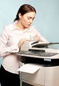 Angry Businesswoman With Copier And Cup Of Coffee