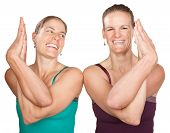 stock photo of namaskar  - Two smiling women in Namaskar pose with twisted hands - JPG