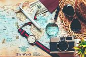 Top View Of Traveler Accessories And Items Man With Black For Planning Travel Vacations On The World poster