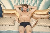 Man In Underpants Relaxing On Bed Luxury Bedroom. Man Sexy Handsome Lover Wait For You. Luxury Relax poster