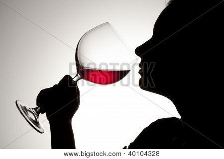 Female Drinking Red Wine