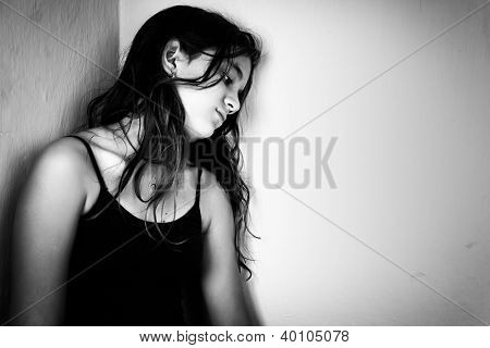 Dramatic black and white portrait of a sad and lonely teenager with space for text