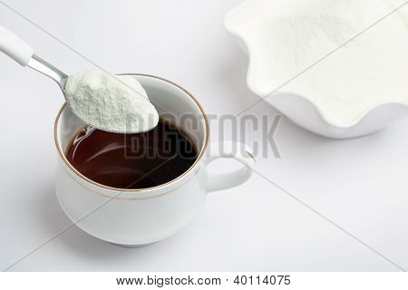 Cup of tea with dairy milk powder