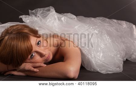 The Young Woman Is Wrapped In Foil On The Floor