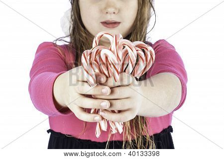 Young Girlg Holding Candy Canes