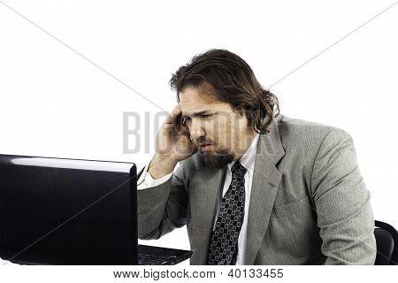 Sad Business Man On Laptop