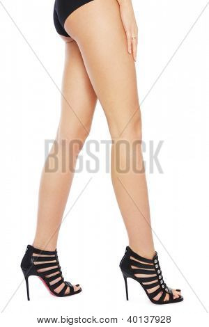 Long beautiful legs of slim sexy woman in stylish shoes, over white background