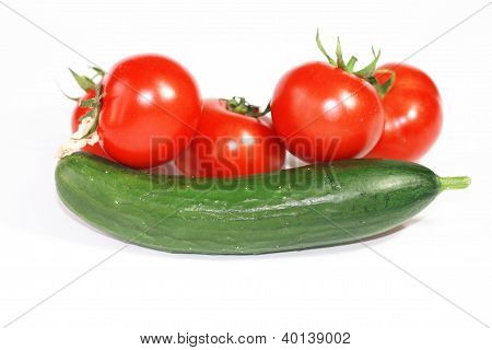 Fresh Cucumber And Tomatoes On White Background