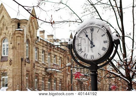 street clock in the snow