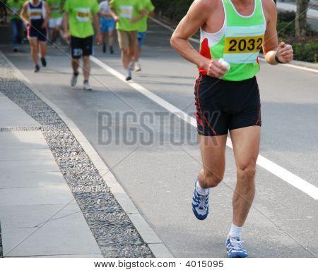 Hangzhou, China - Nov 9, 2008: A Male Marathon Runner Leading A Group