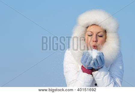 Girl Blows Off Snowflakes From The Hand