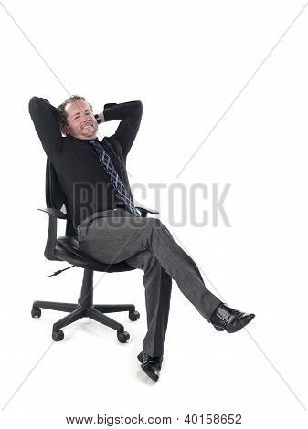 Portrait Of A Doctor Relaxing On Chair