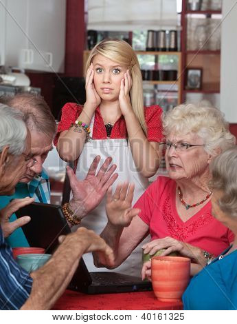 Bickering Seniors And Young Waitress