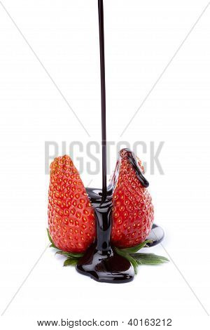 Pouring Chocolate Between Strawberries