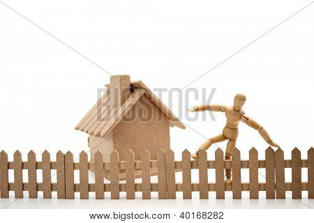 A dummy thief jumping the fence.