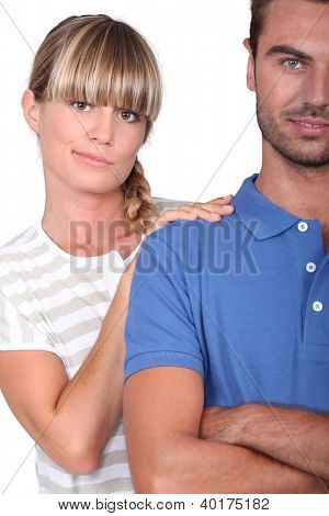 An unsure woman touching her husband's shoulder