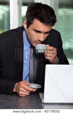Man with computer and coffee cup