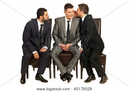 Business Men Telling A Secret