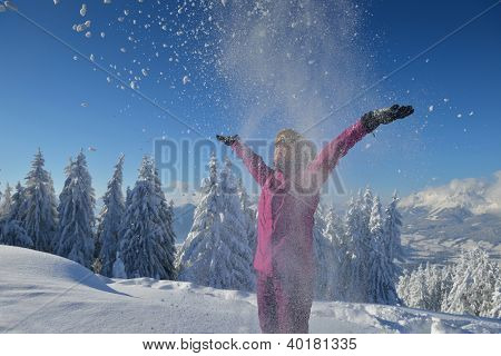happy young ski woman at mountaint top on winter have fun