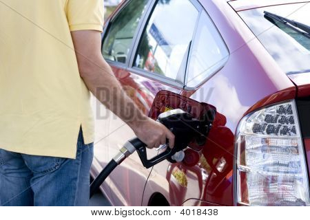 Filling The Tank Of A Car