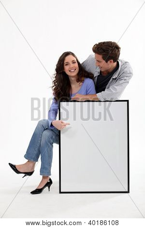 Couple with a picture frame left blank for your image