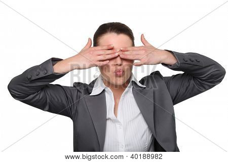 Female office worker covering eyes