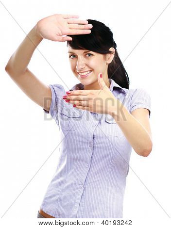 Portrait of a winking young woman making a frame sign with her hands