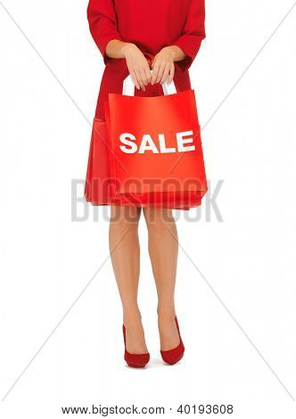 closeup picture of woman on high heels holding shopping bags