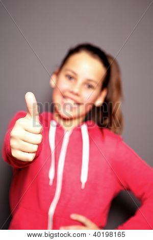 Happy Smiling Child Giving A Thumbs Up