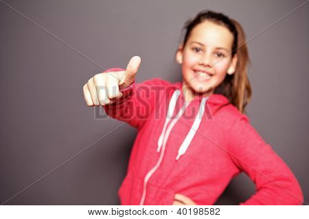 Happy Little Girl Giving Thumbs Up
